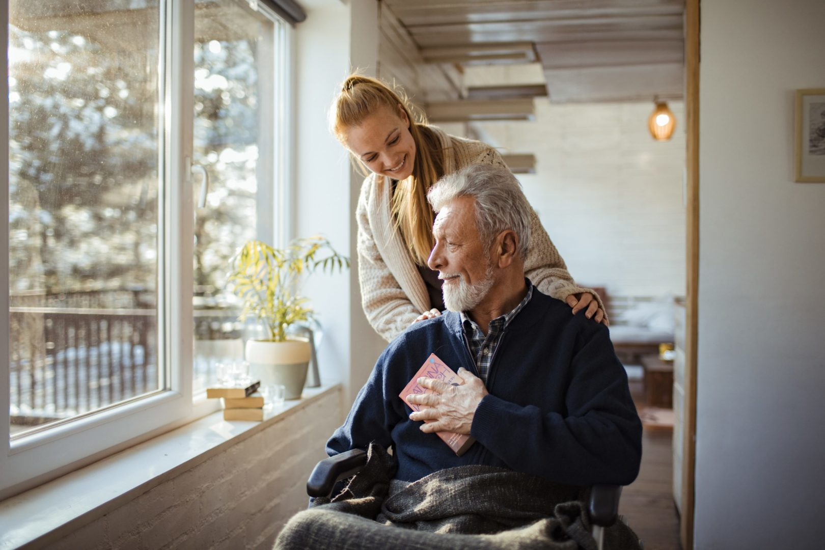 Photo of a granddaughter helping her grandfather around the house